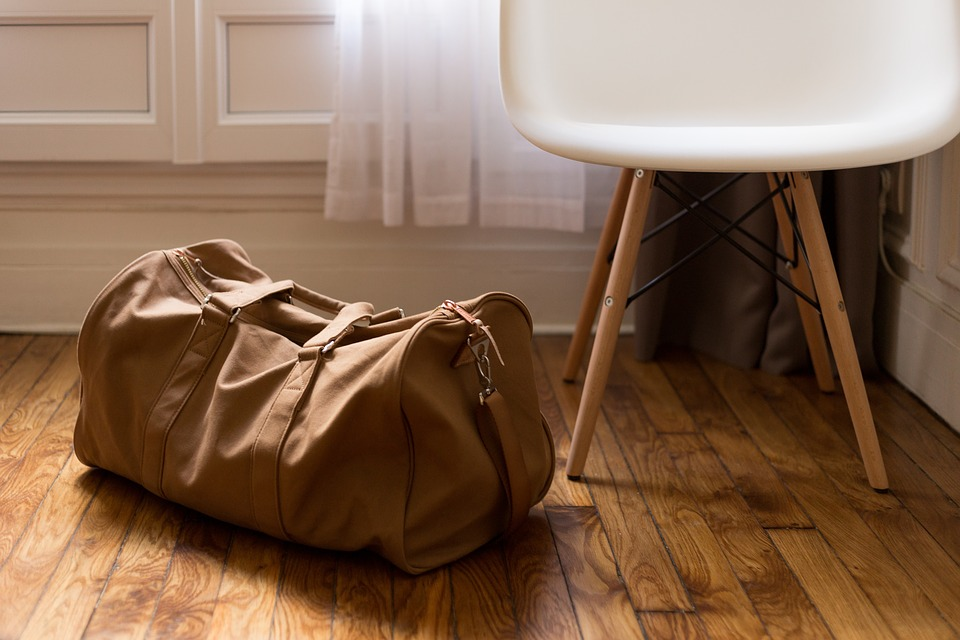 Luggage in the hallway on business travel blog