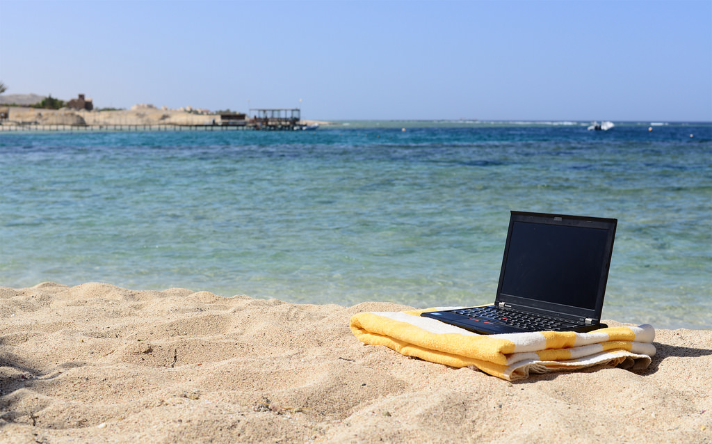 Bleisure laptop on beach